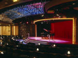 Galaxy Lounge - The main showroom for Crystal's award-winning Broadway-style production shows and headline entertainers features exceptionally comfortable seating and a hydraulic-rising stage for optimum viewing From anywhere in the room. In addition to the sophisticated staging, the acclaimed shows each feature elaborate costumes and sets created by renowned designers with decades of theatrical experience. - Deluxe Cruises 2021-2022-2023-2024