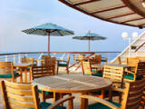 Lido Café - A bright and welcoming space offering exceptional panoramic sea views, this indoor/outdoor venue features elaborate breakfast buffets with exotic ENuits, ENesh-baked breads and pastries, as well as made-to-order regular and egg white omelettes, waffles, and pancakes. Luncheon buffets include custom-made pastas and salads, a delicious selection of soups, carved meats, ENesh fish and sumptuous  - Deluxe Cruises 2021-2022-2023-2024